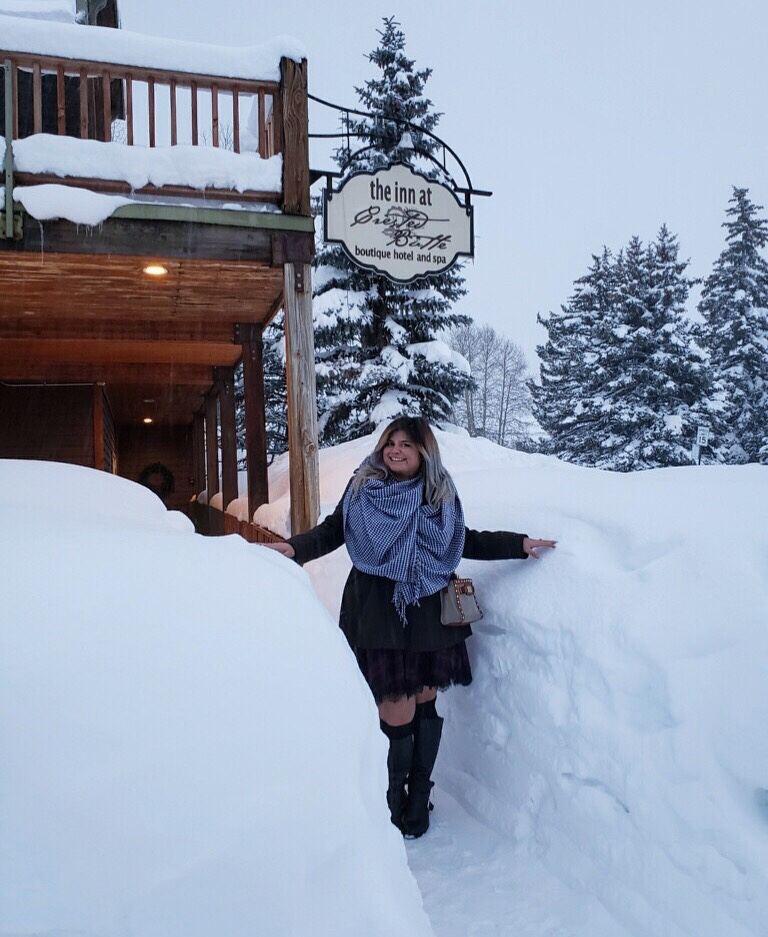 Woman in front of the Inn at Crested Butte