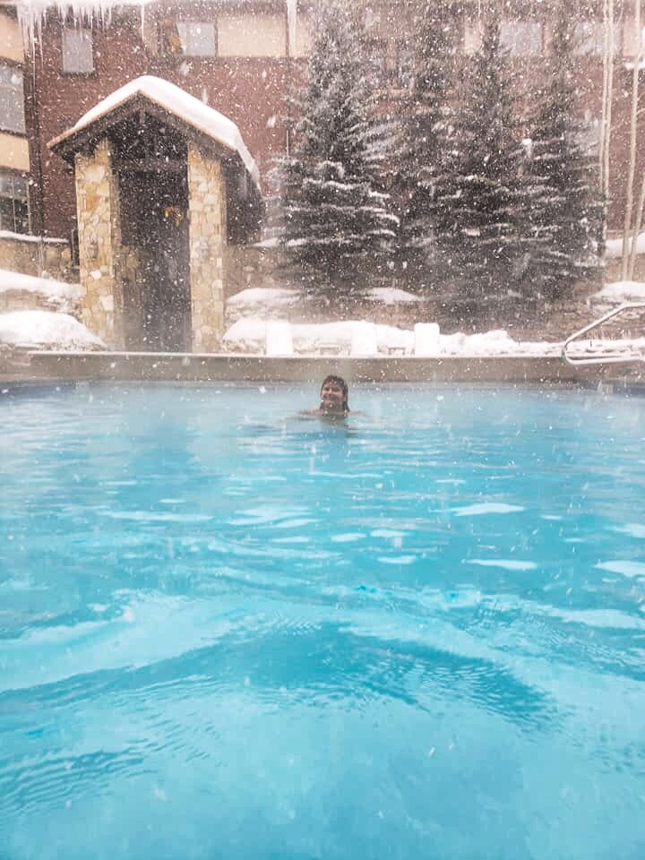 woman swinning in pool at ski resort hotel