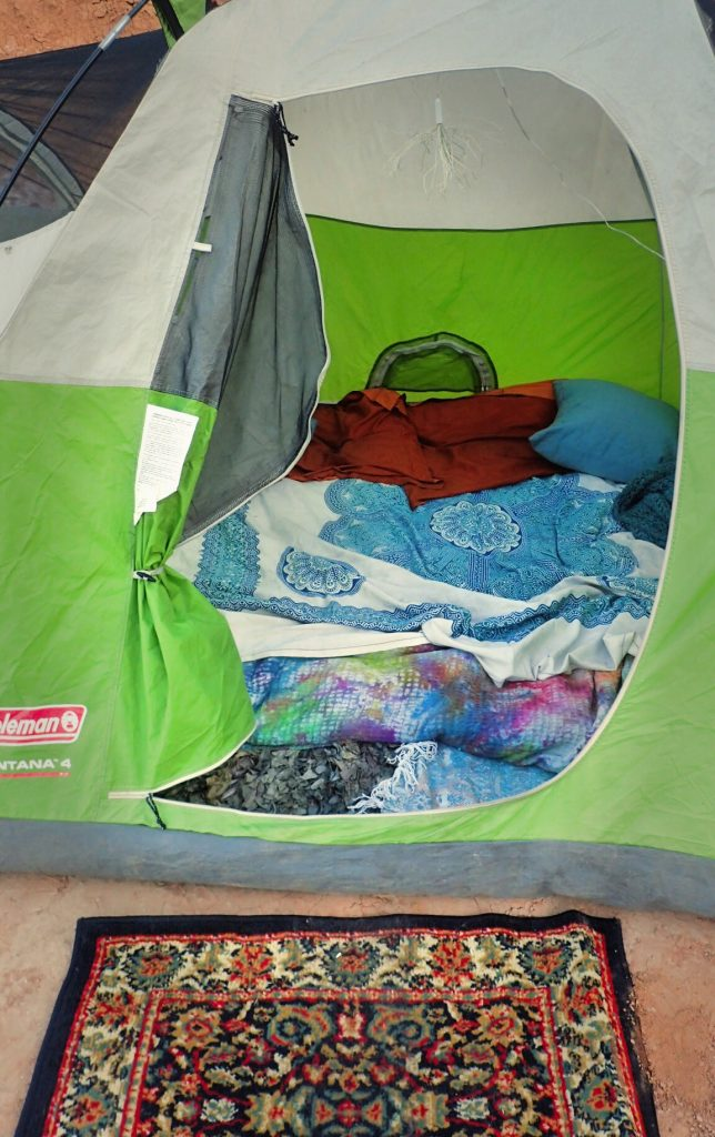 Bed in tent from car camping or camping music festival