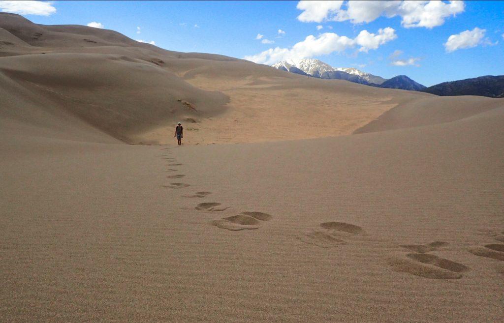 Imange: Man walking in Great Sand Dunes National Park