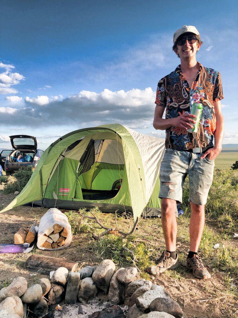 Man standing near tent near Great Sand Dunes National Park