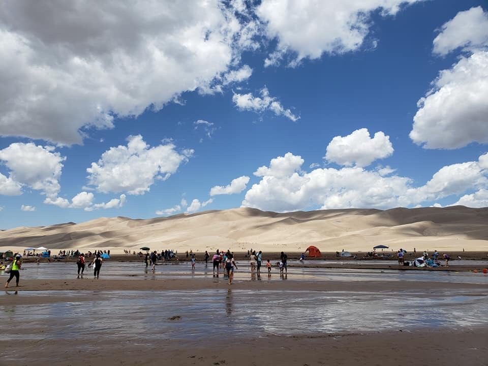 Image: People playing in Medano Creek at Great Sand Dunes National Park